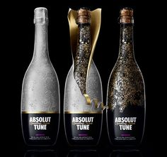 Packaging Design: Absolut Tune is a sparkling fusion of Absolut vodka and crisp white wine. This champagne like bottle has a very Tord Boontje-esque double layered, flowery pattern to it. The caged cork glass bottle has two layers of plastic on it – one with a gold on blue, and the top layer with a matte/pearly white lined with gold that peels back ever so dramatically.