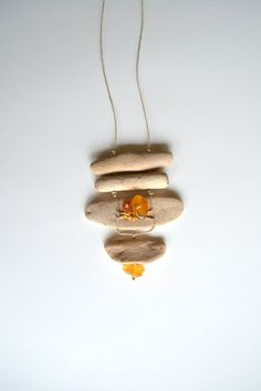 Handmade unique necklace from driftwood and natural Baltic Sea amber