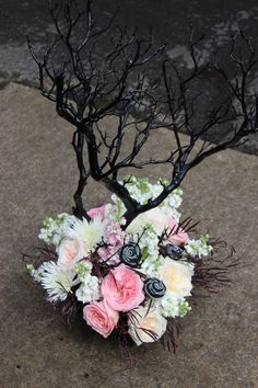 Glam Rock wedding flowers -pink black and white with zipper roses and manzanita tree centerpiece  http://sophisticatedfloral.com/