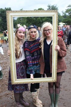 Oxfam style spots: Anna Morton and friends mixed practicality with style opting for vintage jumpers and sheepskin coats at Latitude Festival 2012