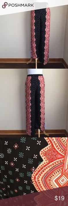 "Xhilaration boho print wide leg pants sz S Xhilaration boho medallion print wide leg pants, size S.  Lightweight flowy material, elastic waist, side pockets, bold medallion scroll print on outer sides with small geometric print accents, see photo 3 for detail.  Condition:  excellent pre-loved.  Material:  100% rayon.  Measurements:  (approximate, taken laying flat): length 39.5"", inseam 29.5"", front rise 10.75"", flat i stretched waist 13"", flat hip 17"", leg opening 10"". Xhilaration Pants…"