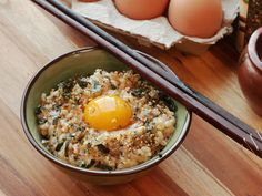 Tamago gohan—rice mixed with a raw egg—is Japanese comfort food at its simplest. Start with a bowl of hot rice, then break an egg into it. Season it with a little soy sauce, salt, and Aji-no-moto, a Japanese brand of pure powdered MSG. Whip it up with a pair of chopsticks until the egg turns pale yellow and foamy and holds the rice in a light, frothy suspension, somewhere between a custard and a meringue.