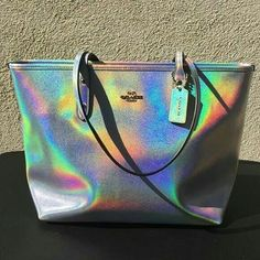 Coach Silver Hologram Tote ✨(A) Brand new w/tags authentic. Bag has small corner wear? I showed it in picture big i promise 😊🤗🤗🤗🤗🍌 Coach Bags Totes Coach Purses, Coach Bags, Capsule Wardrobe, Holographic Fashion, Holographic Purse, Cute Purses, Cute Bags, Luxury Bags, Couture