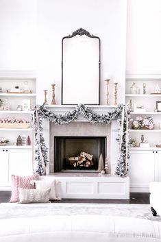 A little tour of our Living Room Christmas Decor this holiday season with the new addition of our living room built-ins. | White living room Christmas decor. | Neutral Christmas decor with hints of pink. | Two story living room Christmas decor. | Two story fireplace Christmas decor. | Mantel Christmas decor inspiration with flocked garland. | Pink Christmas decorations. White Sofas, White Rug, White Pillows, Decorating Blogs, Decorating Your Home, Diy Home Decor, Living Room Built Ins, Living Room Decor, Bedroom Decor