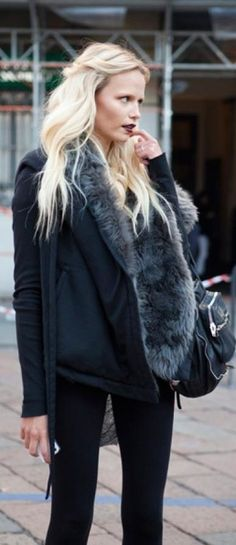 Natasha Poly...all blacked out with a hint of grey faux fur, burgundy lips and blonde hair! <3