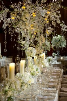 ... white roses, and candles complete this gorgeous centerpiece by {myweddingconcierge.tumblr.com