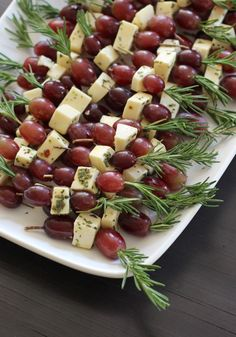 These delicious Grape Fontina Rosemary Skewers are a flavorful and decadent appetizer to make and bring to any get-together. Rosemary sprigs, red pepper, salt, fontina cheese, and purple grapes make a tasty finger food that your guests will love. Finger Food Appetizers, Holiday Appetizers, Appetizers For Party, Finger Foods, Appetizers On Skewers, Toothpick Appetizers, Easter Appetizers, Dinner Parties, Skewer Recipes