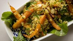 Roast carrot and quinoa salad! With ginger, rocket and parsley.