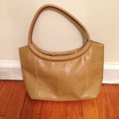 """Camel handbag! Cute camel handbag. It measures 13"""" X 2"""" X 8"""". It's made of faux leather. Excellent condition. Goes with many different outfits. Bundle to save on shipping! NO TRADES, sorry! Bags Shoulder Bags"""