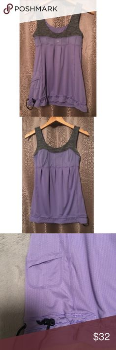 Lululemon Elevate Purple & Gray Tank Top Size 4 Pre-owned, in great condition. Lululemon elevate tank top. Coal gray strata stripe cinch tame me purple. Key locket. Cinched waist. No inside care tag. lululemon athletica Tops Tank Tops