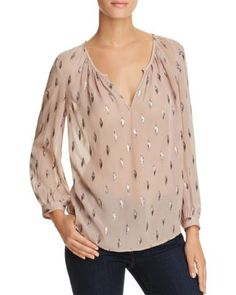 A glimmering metallic leaf pattern bestows this semi-sheer silk blouse from Joie with a healthy dose of radiance, perfect for adding a touch of glamour to work and weekend looks.   Silk/Lurex   Dry cl