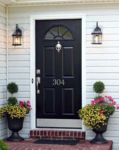Love this front door with the house number decal. Even my exact light fixtures. Different color and knocker.
