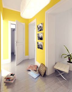 hallway decorating ideas - use a bold colour on walls to create the illusion of space