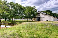 STYLISH HOME, POOL AND 4-STALL BARN ON 5.4 ACRES IN THE ARGYLE ISD