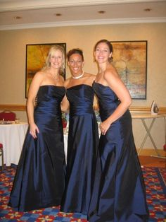 navy blue bridesmaids.  with gold taffeta bolero would be perfect