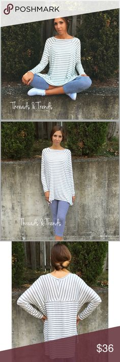 Long Sleeve Striped Tunic LONG SLEEVE STRIPED TUNIC  PRODUCT DESCRIPTION  • long sleeves • slit side hem • rounded neckline • soft, breathable material • relaxed, easy fit  Available in: Heather Gray or Beige  Material Content: rayon & spandex.                         Sizes S/M, M/L, L,XL Tops Tunics