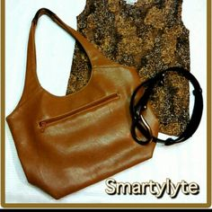 SMARTLYTE LEATHER? HOBO BAG W/ LIGHT BUILT IN! SMARTLYTE -  BROWN LEATHER (I think)HOBO BAG This bag is beautiful and after another look at it, its very hard for me to tell if this is real leather or not. It's hard to tell these days with the perfection of fabric they make now!    *Has a built in light as seen in last picture (hidden in pocket)     *medium Size with 2 Compartments     *Zipper Side Area Inside     *Magnetic Closing     *Zipper in back. See Pictures of Insides Smartylyte Bags…