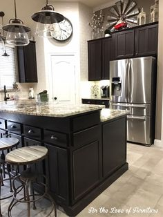 """""""I can't stop looking at how unbelievably gorgeous this kitchen and master bath turned out! I'm calling it 'Farmhouse Chic.' We painted, distressed, added picture molding to the ends for added detail and finished it off with new hardware."""" - For The Love of Furniture and Home Design  This phenomenalmakeover was completed with General Finishes Dark Chocolate Milk Paint and sealed with Gel Topcoat."""