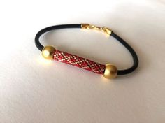 FEATURES OF THE ITEM:  The bracelet is boho style.  The bracelet is useful and beautiful.  This stunning art deco style peyote bracelet is delica beads.  Delica beads, in just two…