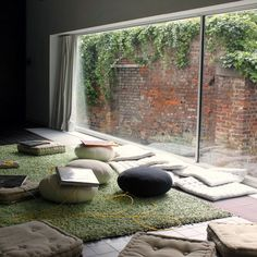 Floor Pillows on a soft rug.