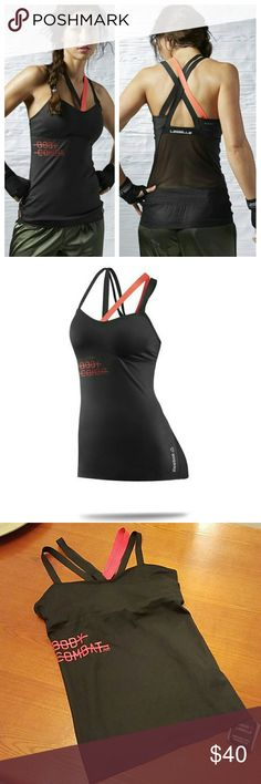 Les Mills Bodycombat Tank Look fierce and fit in this LES MILLS? BODYCOMBAT? Long Bra tailored to the tough jabs and kicks you deliver during class. A built-in medium support bra and flattering straps will give you controlled comfort up front and a knockout look from behind. Reebok Tops Tank Tops