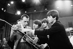 The Beatles teaching Ed Sullivan how to play the guitar