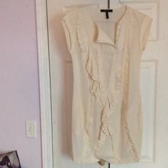 BCBG Maxaria cream colored long blouse. Size XS Slightly worn BCBG long top.  Cream colored.   Looks nice with leggings.   Frills in front and pockets on sides. BCBGMaxAzria Tops Blouses
