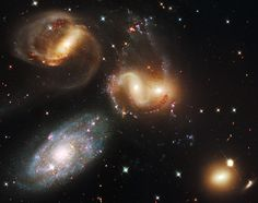 Day 11 of the 2013 Hubble Space Telescope Advent Calendar, one of 25 photos eventually. Galaxy group Stephan's Quintet is 290 million light-years away, in the constellation Pegasus. Four of these five galaxies are actually close enough to be locked in a vast intricate dance. Galaxy NGC 7320, the brighter galaxy at lower left, appears to be part of the group, but is in fact 250 million light years closer than the others. (NASA, ESA, and the Hubble SM4 ERO Team)