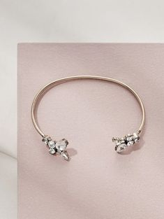 Simple and refined, this slim bangle with a beautiful floral silhouette will make you want to wear it non-stop. Adjust to fit on your wrist, or higher up along your arm. Is the finishing touch for brunch with the girls, a wedding or fancy soiree. Crystal Bracelets, Silver Bracelets, Cuff Bracelets, Bangle, Wedding Earrings Drop, Wedding Bracelet, Bridesmaid Jewelry, Wedding Jewelry, Fashion Jewellery Online