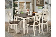 """The Whitesburg Dining Room Table from Ashley Furniture HomeStore (AFHS.com). With the warm two-tone look of the cottage white and burnished brown finishes beautifully accenting the stylish cottage design, the """"Whitesburg"""" dining collection creates an inviting cottage retreat within the décor of any dining room."""