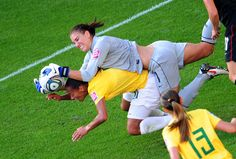 American goalkeeper Hope Solo falls on Brazil's defender Rosana as she saves the ball during the quarter-final match on July 10, 2011 in Dresden, Germany. (Johannes Eisele/AFP/Getty Images)