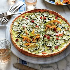 Zucchini and Goat Cheese Quiche - Is there anything more French than a savory vegetable quiche? Choose fresh-looking, smooth-skinned zucchini. If you have a vegetable garden, add strips of squash blossom to the tart, as well. Crumbled goat cheese and diced ham give the tart a complex flavor.