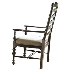 Ladder-back arm chair with turned front legs and an upholstered seat. Product: ChairConstruction Material: Wood ...
