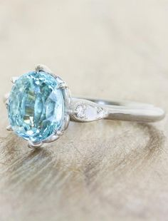 A one-of-a-kind blue/green Paraiba oval cut gem is set in a basket handcrafted with intricate details, on a platinum band set with delicate opals and diamonds. Oval Solitaire Engagement Ring, Gemstone Engagement Rings, Engagement Jewelry, Blue Topaz Ring, Sapphire Gemstone, Magic Day, Rings N Things, December 2014, Opal
