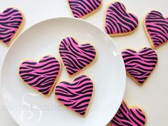 Here's a quick tutorial on how to make zebra print cookies with royal icing.This is what you'll need for this project:  Roll out cookie dough (My orange vanilla spicecookie recipeis available in the tutorial shop Heart shaped cookie cutter