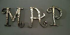 7 yrs bad luck? or just another excuse for a project. I used a broken mirror and some premade letters to make these initials for a xmas present. I made them double sided so they could be hung out in the sun... and twirl around and drive the cats crazy with a lazer light show
