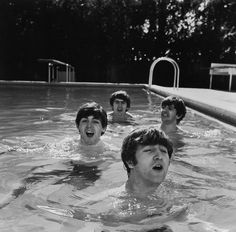 1964   Four lads from Liverpool — Paul McCartney, George Harrison, John Lennon, and Ringo Starr — take a dip in an unheated Miami Beach swimming pool during a cold snap on their first trip to the States.