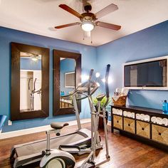 I like the lay out. Would have it so I could exchange and store elliptical and total gym. I imagine mirror next to closet doors, so equipment in this room would be reversed. I like the towel, cleaner, and water storage beneath a wall mounted tv