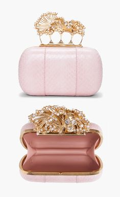 The subtle blush color of this alexander mcqueen clutch is so insouciant with the gold skull.