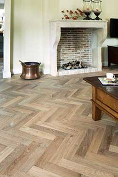 An old faithful with a contemporary twist. The herringbone pattern, along with the chevron, is probably the oldest parquet, with still-extant examples dating back to the mid-1500s. The owners of this residence wanted a classic herringbone wooden floor, but with a modern edge.