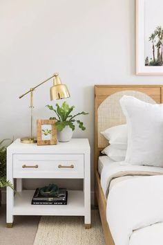 If you're not into striking silhouettes, one modern bedroom lighting idea you can try is a classic lamp in a metallic tone or even a sleek plastic lamp for a simple vibe.