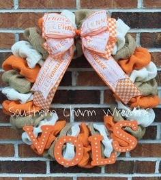 18 University of Tennessee orange, white, and natural burlap Wreath. Decorated with wooden hand painted letters and layered UT bow. Perfect for any UT fan!!! .  I personally make each wreath, and take great pride in my strict attention to detail. My wreaths are an excellent way to welcome your visitors, starting outside!  Wreaths are the perfect gift, for birthdays, anniversaries, or just to show you care! If you do not see exactly what you are looking for, please contact me to design a…