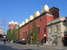 Dalí. Yes those are eggs, and yes, that is bread on the museum.