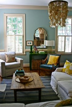 casual living room- Benjamin Moore's Wythe Blue more subtle but still has pops of green and yellow nice!