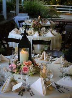 Lanterns with flowers as centerpieces