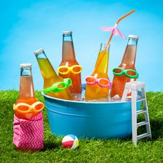 The key to making the perfect pool party for your drinks: Bottle goggles and a beverage container.