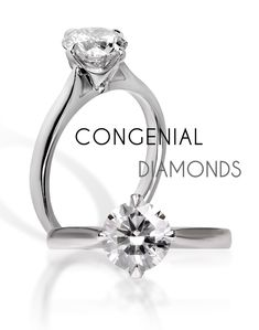 The traditional solitaire diamond engagement ring with a compass setting
