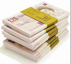 Eight packs of 20 Pound Notes:  8,000 British Pounds Sterling
