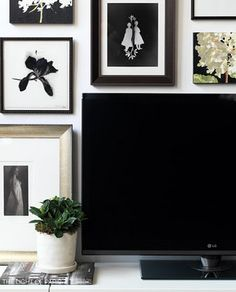 Hide the TV in plain sight by surrounding it with framed art