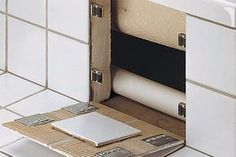 Schluter-REMA - Schluter-Systems - magnetic latch system for concealment in tiled walls